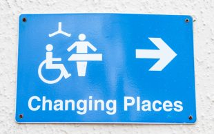 The Changing Places logo in white on a bright blue background.