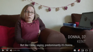 A screenshot from Donna's film showing Donna talking on her sofa.